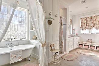 Comfy-shabby-chic-bathroom-in-white-with-claw-foot-bathtub