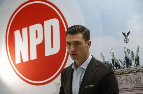 Far-right NPD party leader Franz introduces state election campaing poster in Berlin