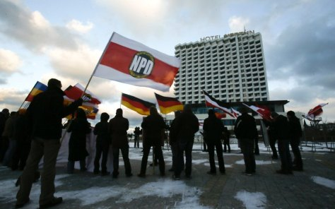 NPD party members attend protest rally in front of hotel where German state ministers are holding conference in Rostock